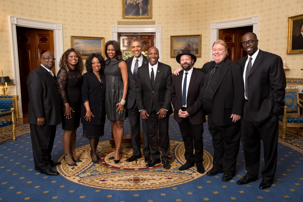 "President Barack Obama and First Lady Michelle Obama greet the house band in the Blue Room prior to prior to hosting ""The Gospel Tradition: In Performance at the White House"" in the East Room of the White House, April 14, 2015. (Official White House Photo by Amanda Lucidon) This photograph is provided by THE WHITE HOUSE as a courtesy and may be printed by the subject(s) in the photograph for personal use only. The photograph may not be manipulated in any way and may not otherwise be reproduced, disseminated or broadcast, without the written permission of the White House Photo Office. This photograph may not be used in any commercial or political materials, advertisements, emails, products, promotions that in any way suggests approval or endorsement of the President, the First Family, or the White House."